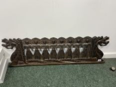 A CARVED WOOD PANEL PIERCED AND CARVED WITH EIGHT LADIES STANDING ON THE TAILS OF TWO DRAGONS, THEIR