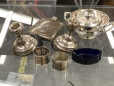 A PAIR OF SILVER HALLMARKED WEIGHTED CANDLESTICKS TOGETHER WITH A SMALL QUANTITY OF SILVER PLATED