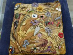 A QUANTITY COSTUME BROOCHES ON A TAPESTRY CUSHION