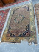 AN ANTIQUE PERSIAN KASHAN RUG, 216 x 132cms TOGETHER WITH AN ANTIQUE CAUCASIAN SHIRIVAN RUG, 176 x