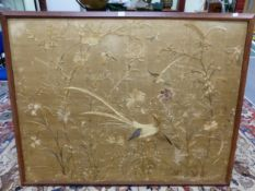 AN OAK FRAMED CHINESE SILKWORK PANEL EMBROIDERED WITH A PHEASANT, SONG BIRDS AND FLOWERS. 99 x