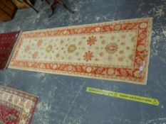 AN ORIENTAL RUG OF CAUCASIAN DESIGN, 194 x 120cms TOGETHER WITH AN ORIENTAL RUNNER OF PERSIAN