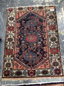 TWO ANTIQUE PERSIAN HAMADAN RUGS, 145 x 107 AND 197 x 135cms (2)
