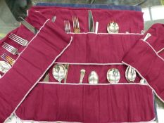 A GROUP OF SILVER PLATED CUTLERY IN CUTLERY WRAPS BY OSBOURNE