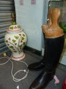 A PAIR OF RIDING BOOTS AND A LARGE TABLE LAMP