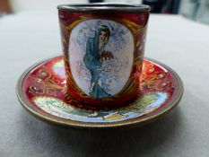 A CONTINENTAL RED ENAMEL ART NOUVEAU CUP AND SAUCER WITH DESIGNS IN THE MANNER OF ALPHONCE MUCHA