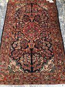 A PERSIAN SAROUK RUG, 203 x 125cms