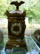A BRASS MANTEL CLOCK THE MOVEMENT SIGNED AD . MOUGIN