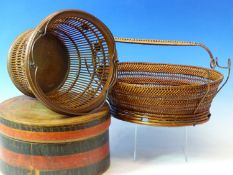 TWO BASKETS, ONE WITH AN OVAL WOODEN BASE AND WOVEN HANDLE. 29cms. THE OTHER WITH CIRCULAR WOODEN