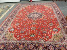 A PERSIAN KASHAN CARPET, 433 x 319cms