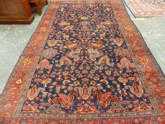 AN ANTIQUE PERSIAN BIDJAR CARPET, 379 x 221cms