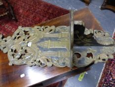 A PAIR OF TURKISH TURBAN STANDS CARVED AND PAINTED WITH FLOWERS ON A BLACK GROUND AROUND MINARETS. H