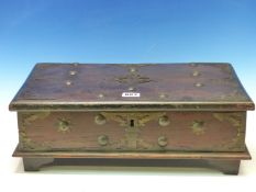 AN INDO-PORTUGUESE ROSEWOOD BOX MOUNTED WITH BRASS PIERCED DECORATION AND STUDS,THE EDGES OF THE