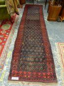 AN ANTIQUE PERSIAN TRIBAL RUNNER, 446 x 105cms