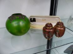 A ART NOUVEAU GREEN GLASS AND METAL MOUNTED GLOBE VASE IN A MANNER OF LOETZ, TOGETHER WITH A PAIR OF