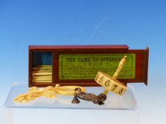 A BOXED GAME OF IVORY SPELLICANS, A BONE SPINNING DIE, A FLORAL CARVED IVORY CROSS PENDANT AND A