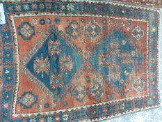 AN ANTIQUE CAUCASIAN KAZAK RUG, 180 x 133cms