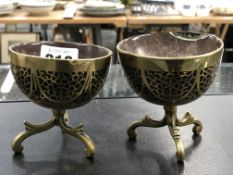 A PAIR OF ANTIQUE COCONUT AND BRASS, INLAID THREE FOOTED BOWLS.
