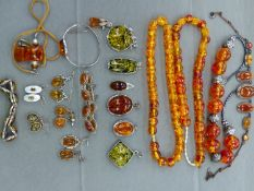 A QUANTITY OF FAUX AMBER JEWELLERY TOGETHER WITH A PAIR OF CITRINE AND PEARL EARRINGS.