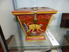A PAINTED STORAGE BOX DECORATED WITH A PRIMATE