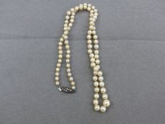 A ROW OF GRADUATED PEARLS WITH A SILVER AND MARCASITE CLASP