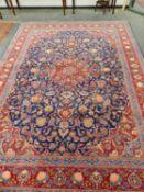 A PERSIAN KESHAN CARPET, 372 x 277cms