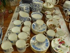 A MINTON SHALIMAR PATTERN HEART TEA SERVICE, TOGETHER WITH A COALPORT REVELRY PATTERN COFFEE CANS