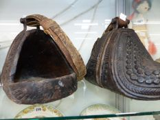 A PAIR OF ANTIQUE PERSIAN WOOD AND IRON STIRRUPS