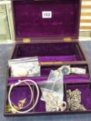 A LEATHER JEWELLERY CASE CONTAINING A PORTRAIT CAMEO SHELL, AN ELLESSE WATCH, TWO SILVER BANGLES,