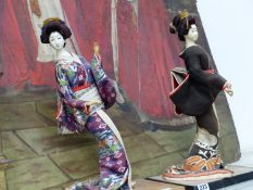 TWO JAPANESE TRADITIONALLY DRESSED LADIES
