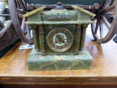 A VICTORIAN ONYX CASED MANTLE CLOCK.