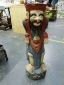 A CARVED PAINTED EASTERN FIGURE