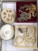 A CASED SET OF SILVER AND ENAMEL DRESS STUDS, TOGETHER WITH A STRING OF PEARLS WITH A PASTE AND