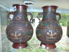 A PAIR OF CHINESE BRONZE AND ENAMEL VASES