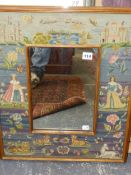 AN UNUSUAL NEEDLEWORK FRAME MIRROR DECORATED WITH COURTLY FIGURES AND ANIMALS. 60 x 49cms TOGETHER