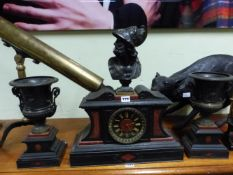 A 19th C. GRAND TOUR CLOCK GARNITURE, THE RED STONE ORNAMENTED BLACK SLATE CLOCK CASE SURMOUNTED BY
