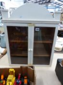A TWO DOOR SMALL WALL DISPLAY CABINET
