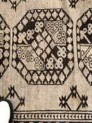 AN AFGHAN BOKHARA RUG, 223 x 107cms