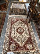 TWO ORIENTAL SMALL RUGS OF BOKHARA DESIGN TOGETHER WITH ANOTHER OF PERSIAN DESIGN, LARGEST 94 x