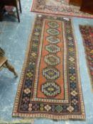 AN ANTIQUE CAUCASIAN KAZAK RUG. 236 x 98cms