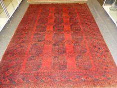 AN AFGHAN BOKHARA CARPET, 295 x 203cms