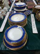 A BOOTHS POWDER BLUE AND GILT PART DINNER SERVICE