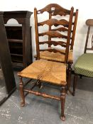 A PAIR OF ARTS AND CRAFTS STYLE, RUSH SEAT LADDER BACK CHAIRS.