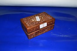 CARVED WOODEN BOX CONTAINING A QUANTITY OF COINS OF MEDALS INCLUDING COMMEMORATIVE CROWNS AND