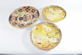 Pair of Japanese Satsuma ware plates with floral decoration and a further Imari style dish (3)