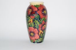 "Modern Moorcroft vase with a floral design, the base marked ""Trial"" dated 28/11/02, 26cm high"