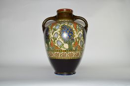 Large Gouda two-handled baluster vase decorated in typical fashion, 43cm high