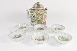 Chinese porcelain tea pot in Cantonese style decorated in famille rose, and a group of six small