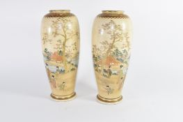 Pair of cylindrical Satsuma ware vases decorated with Japanese figures in landscapes (2)