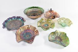 Group of Fenton and other manufacturers of Carnival glass, all with coloured purple and green floral